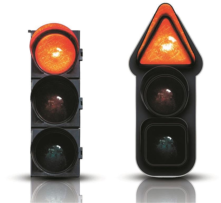 Standarta un nākotnes tipa luksofors. Pateicoties trīs dažādām signālu formām, satiksmē var piedalīties arī tie vadītāji, kuri neatšķir krāsas.