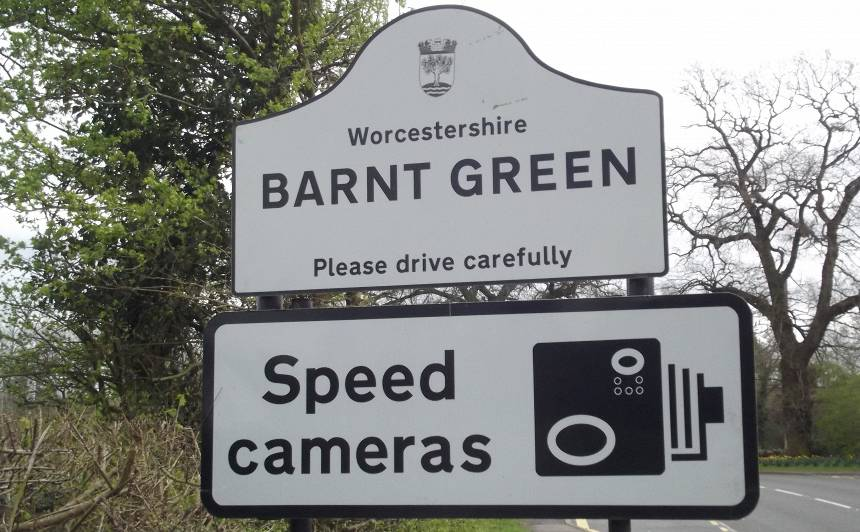 Kendal End Road in Barnt Green.   Sign -   Worcestershire  Barnt Green  Please drive carefully   Speed cameras